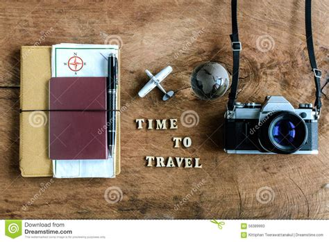 Notebook With Map Passport And Camera On Wooden