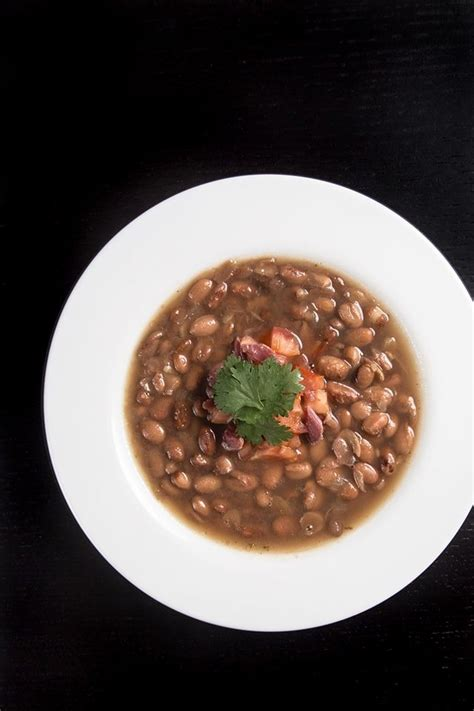Other than breakfast, our menu was always pinto beans with ham hocks, fried tators. Pressure Cooker (Instant Pot) Smoky Ham Hock and Pinto Bean Soup