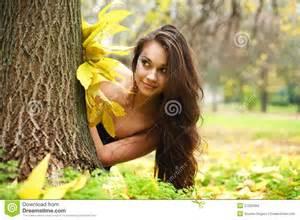 Girl Hiding Behind Tree