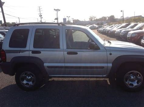 find   jeep liberty sport suv silver gray wd