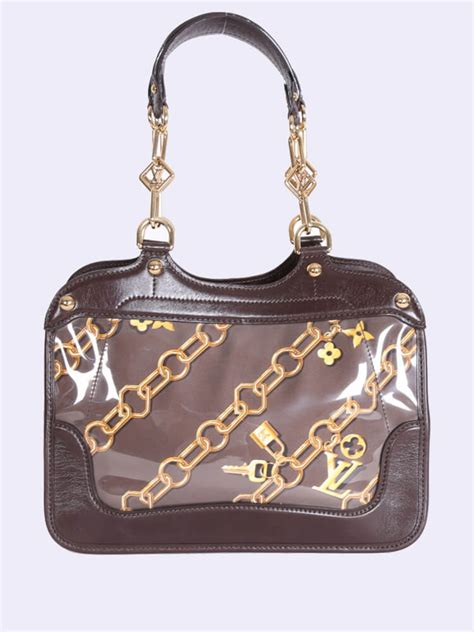 louis vuitton cabas limited monogram charms bag brown