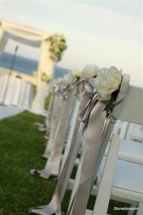 wedding chairs simple flower with ribbon