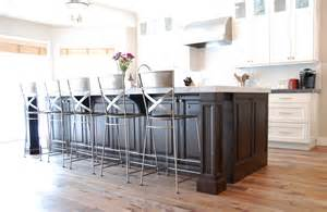 kitchen island with built in table a transitional white kitchen with a cherry wood