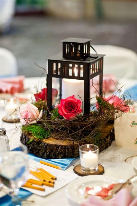centerpieces with lanterns my wood slice lantern centerpieces weddingbee photo gallery