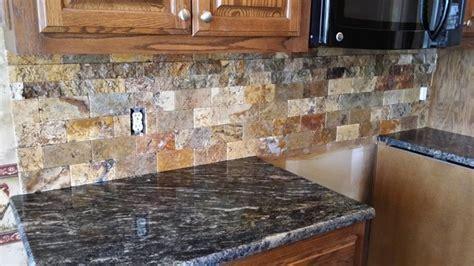 Scabos Split face tile backsplash with Cordoba Granite