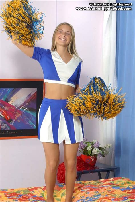 Lovely Cheerleader Teases With Her Tight Sporty Bum XBabe