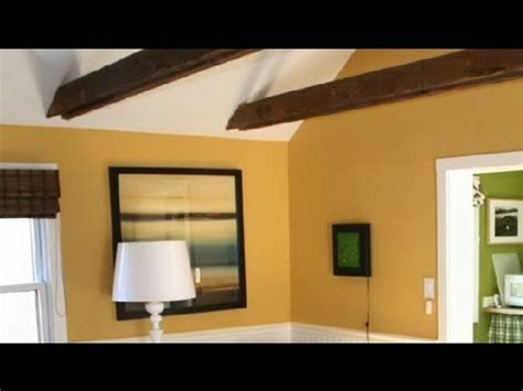 colors to warm a vaulted ceiling in a large room