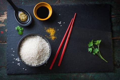 top view  rice bowl   red chopsticks photo