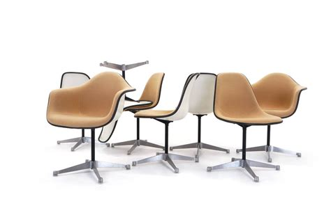 set of eight upholstered eames swivel dining chairs two