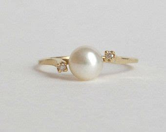 non traditional engagement ring classic and understated modern pearl diamond ring 14k gold
