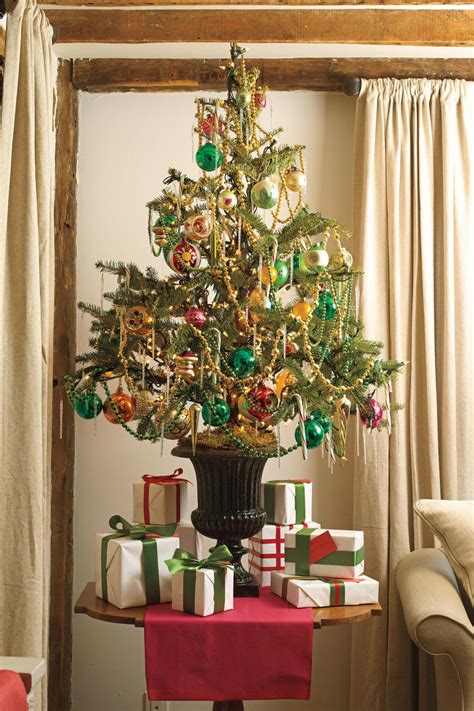table top christmas tree in pleiglass with falling snow tree decorating ideas southern living
