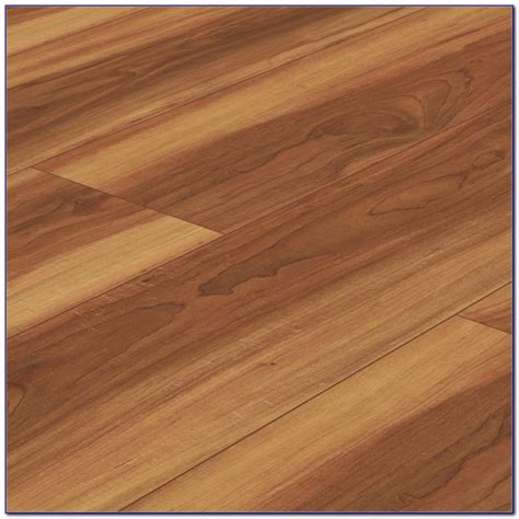 scraped vinyl plank flooring hand scraped pecan vinyl plank flooring flooring home design ideas 2md9zxqlqo92223