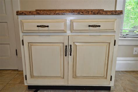 Ideas For Refinishing Kitchen Cabinets - thrifty artsy girl white glazed cabinet transformations a review a year later