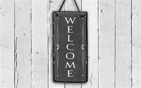 """A large, windowless wall is the perfect canvas for creative decor. 30 Inspirations In-a-word """"welcome"""" Wall Decor by Fireside Home"""