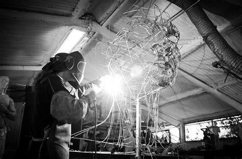 metal work sculptures play tribute  human emotions  strength
