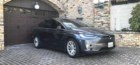 Financial news · print and mobile access · latest trends & insights Tesla Model X with extreme mileage racked up $29,000 in ...