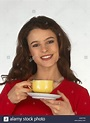 RACHAEL SPEED IN RED SWEATER YELLOW CUP SAUCER Stock Photo ...