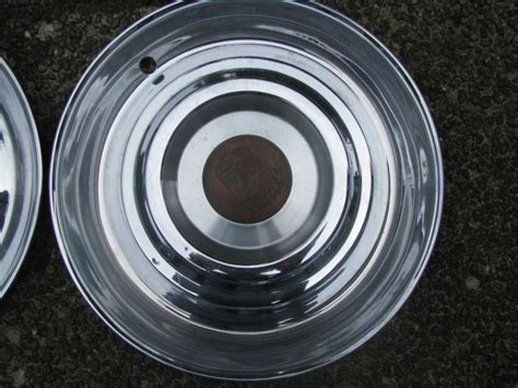 find  cadillac hubcaps set   nice condition