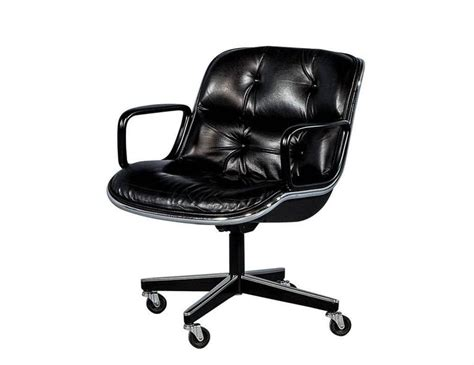 pair of vintage black leather tufted office chairs