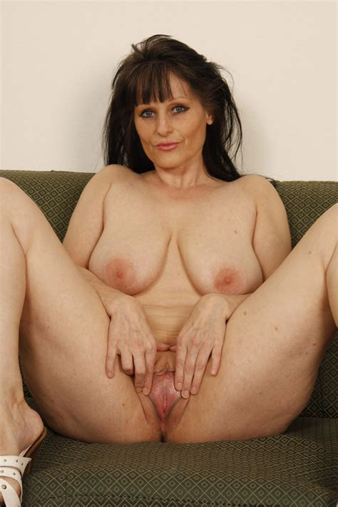 big breasted brunette mature strips naked and takes black cock in her loose pussy
