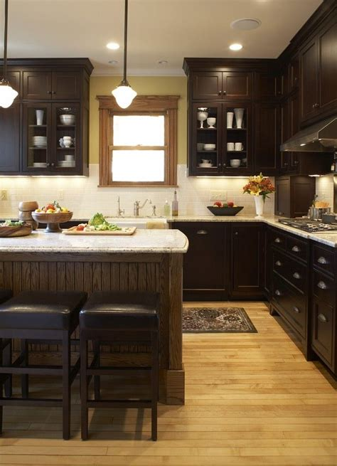 dark cabinets with wood floors kitchen dark cabinets warm wood floor light counters