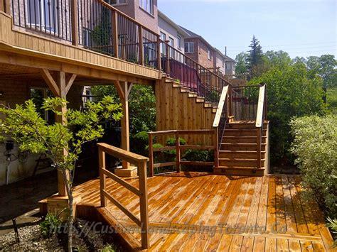 basement walkout interlock  deck  pergola toronto landscaping design interlock