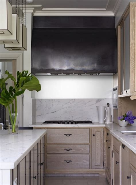 kitchen with light pickled oak cabinets and marble
