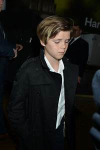 Brooklyn Beckham supported by parents Victoria and David ...