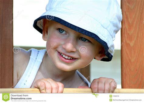 toddler boy peeking   window stock photo image