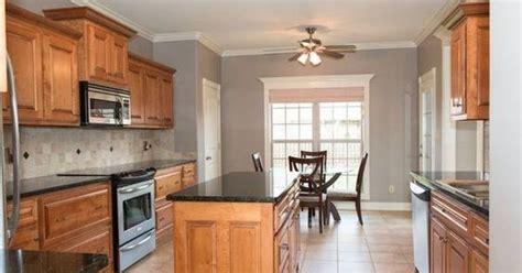 neutral grey walls medium  warm honey cabinets