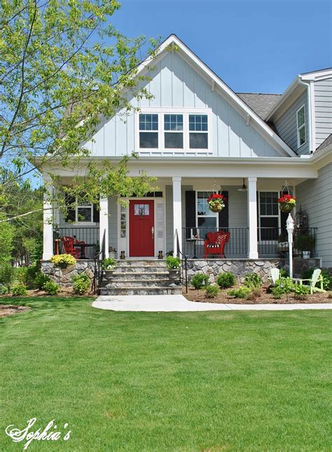 cottage farm s farmhouse style front porch with pops of