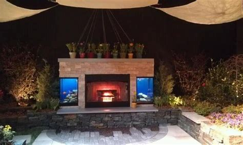 outdoor living space fish tanks   fireplace