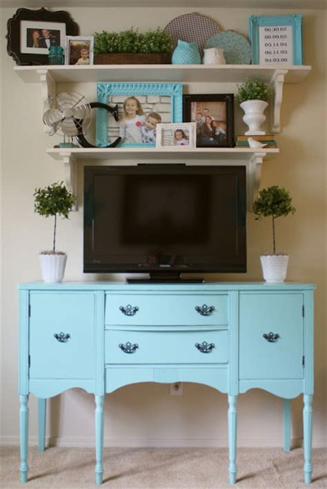 hide your television when not in use by building this tv lift 5 tips for decorating around a television home stories a