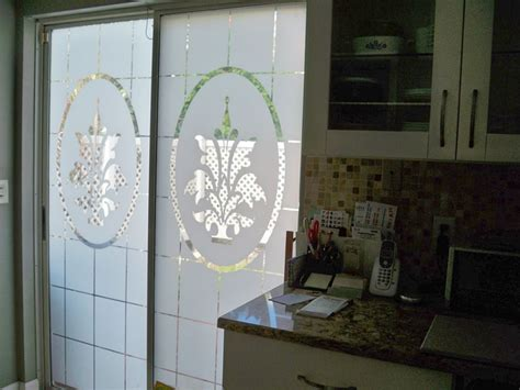 etched glass decorates sliding glass doors for 14