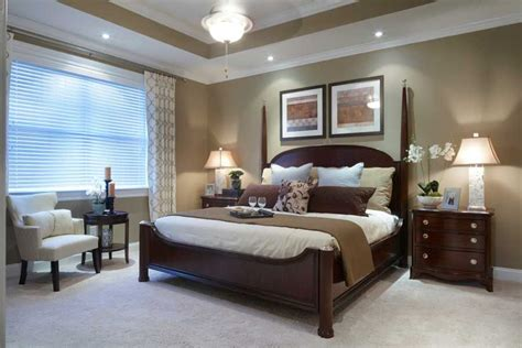 great master bedroom wall color  white molding  post bed reading area bedding