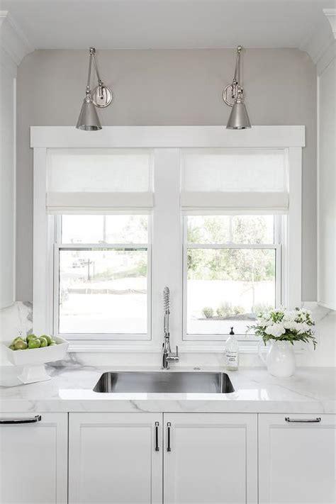 sconce over kitchen sink kitchen window above sink design ideas