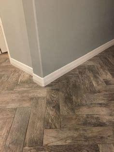 pergo flooring herringbone new floor is in pergo max river road oak lowe s my