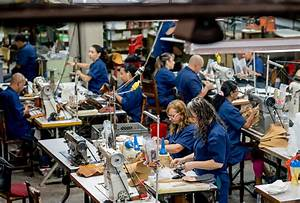 Manual Workers Working At A Factory Stock Photo
