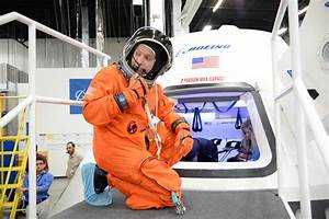 Spacesuited Astronauts Climb Aboard Boeing CST-100 ...