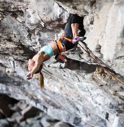 Rock Climber Courtney Woods Rests Her Arms During Climb