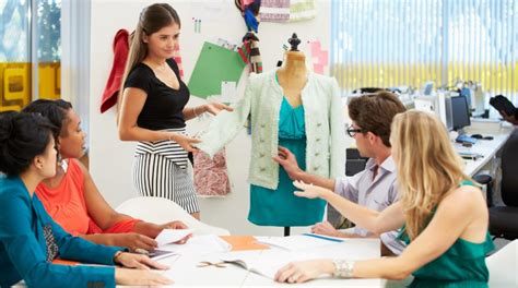 fashion design schools meeting in fashion design studio discussing ideas