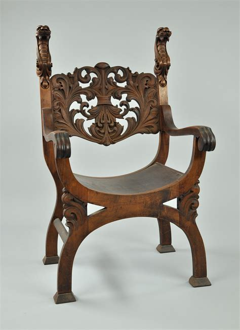 a carved wood arm chair with serpent motif 11 21 09 sold