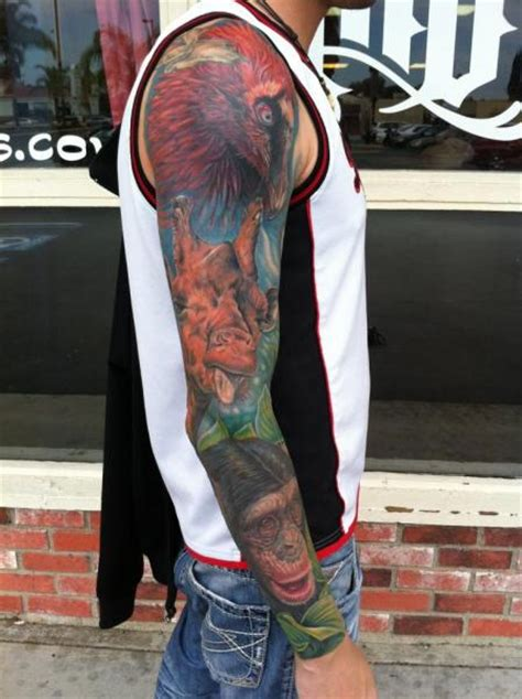 arm realistic bird monkey giraffe tattoo  mike devries