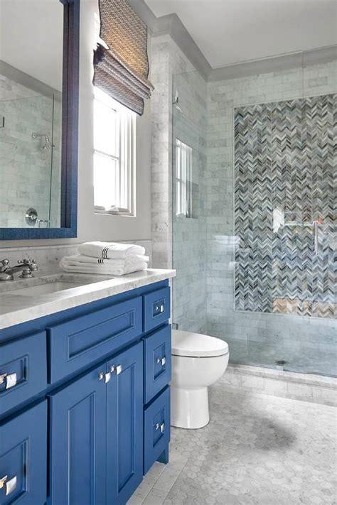 light blue washstand  gray glass backsplash tiles