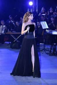 nancy ajram wearing long black dress with acut from With robe soirée nancy