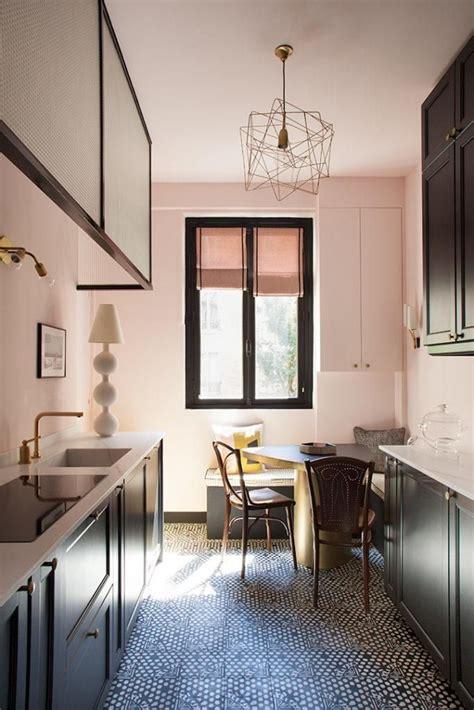 light pink kitchen  dark cabinets  modern features