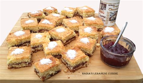 samsung cuisine almond and coconut sheet cake filled with jam hadia 39 s