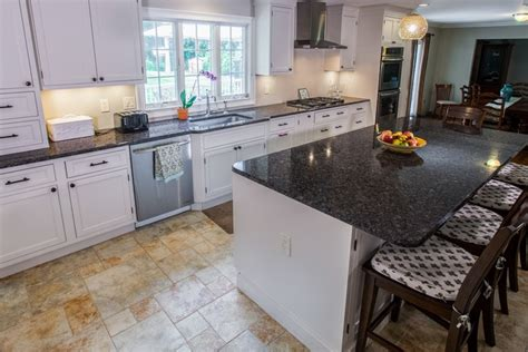 white kitchen cabinets and black countertops white cabinets paired with countertops kitchen design 2049