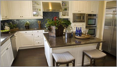white kitchen brown cabinets with granite countertops