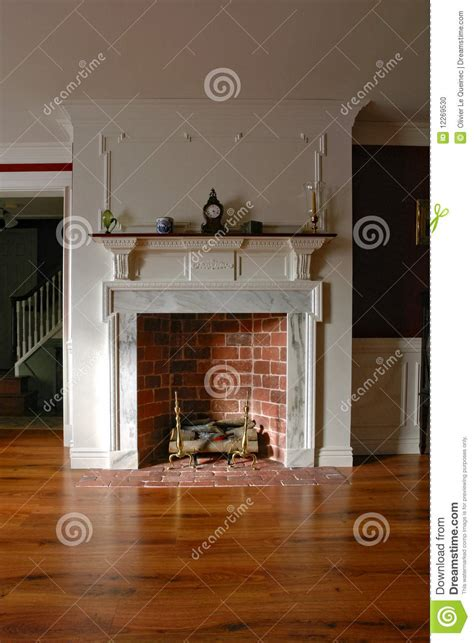 brick kitchen flooring fireplace in antique colonial style home interior stock 1790